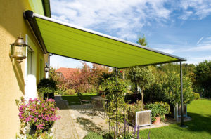 Bright green retractable awning an example of a practical modern style alfresco lifestyle structure