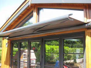 partially extended retractable awning for  a kitchen bifold door shade solution
